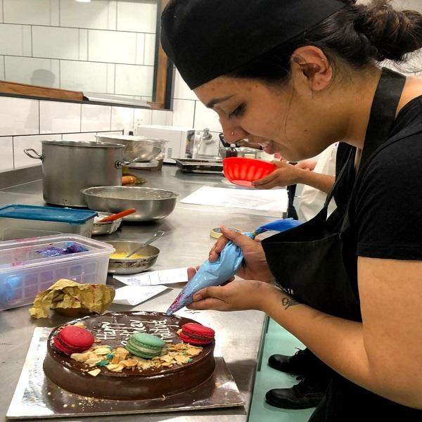 Tanvi presenting cake
